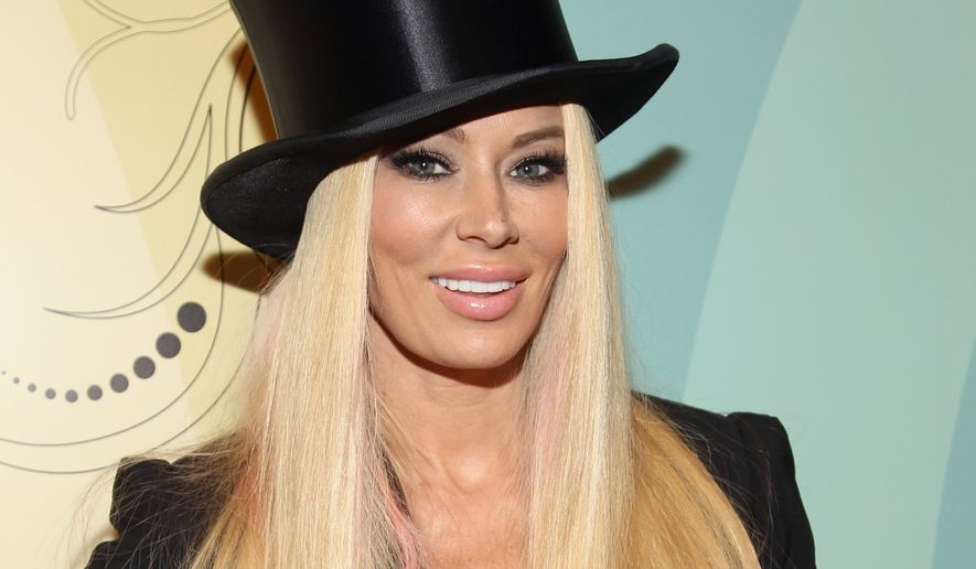 Former adult film star Jenna Jameson arrives at Perez Hilton's 34th Birthday and Mad Hatter's Ball on March 24, 2012, at Siren Studios in Los Angeles. (Associated Press/Donald Trail for Perez Hilton) ** FILE **