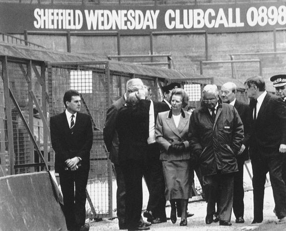 **FILE** Britain's Prime Minister Margaret Thatcher, surrounded by officials, visits the Sheffield football stadium in Sheffield, England on April 16, 1989, where yesterday, 108 supporters were killed in a crush, at the start of a cup semi-final. (AP Photo)