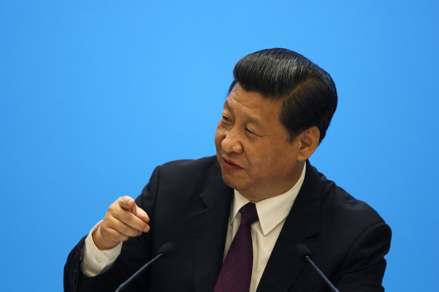 ** FILE ** Chinese President Xi Jinping speaks during a meeting with representatives of entrepreneurs at the annual Boao Forum in Boao, in southern China's Hainan province, on April 8, 2013. (Associated Press)