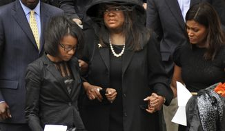 ** FILE ** Chaz Ebert (center), widow of film critic Roger Ebert, leaves Holy Name Cathedral in Chicago after his funeral on Monday, April 8, 2013. Mr. Ebert, a Pulitzer Prize-winning movie reviewer, died Thursday at age 70 after a long battle with cancer. (AP Photo/Paul Beaty)