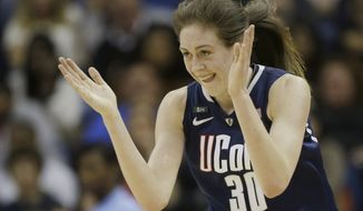 Connecticut forward Breanna Stewart (30) reacts after making a three-point basket against Notre Dame during the first half at the women's NCAA Final Four college basketball tournament semifinal against Notre Dame, Sunday, April 7, 2013, in New Orleans. (AP Photo/Dave Martin)