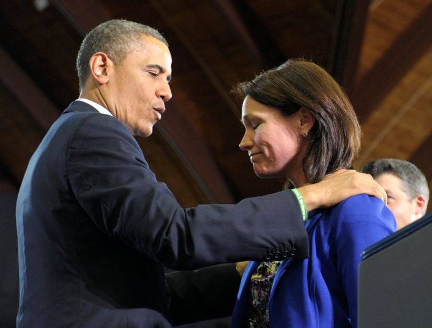 President Obama comforts Nicole Hockley on Monday at the University of Hartford in Connecticut. Mrs. Hockley and her husband, Ian, lost their son, Dylan, in the Sandy Hook Elementary School shooting in December. Mr. Obama is pushing Congress to hold votes on the gun controls he has proposed. (Associated Press)