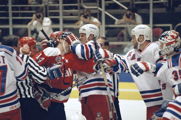 **FILE** Washington Capitals' Pat Peake (14) and New York Rangers' Joey Kocur exchange blows during first period Playoff action, Monday, May 9, 1994 at Madison Square Garden in New York. (AP Photo/Kathy Willens)