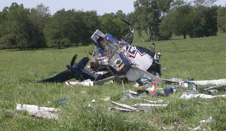 ** FILE ** This photo provided by the National Transportation Safety Board, shows the wreckage of a helicopter that crashed near Mosby, Mo., on Aug. 26, 2011. The pilot of an emergency medical helicopter may have been distracted by text messages when he failed to refuel his helicopter and misjudged how far he could fly before running out of fuel. (AP Photo/NTSB)