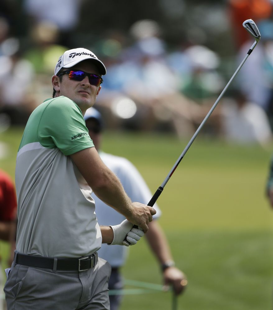 Justin Rose, of England, watches his tee shot on the third hole during a practice round for the Masters golf tournament Tuesday, April 9, 2013, in Augusta, Ga. (AP Photo/Darron Cummings)
