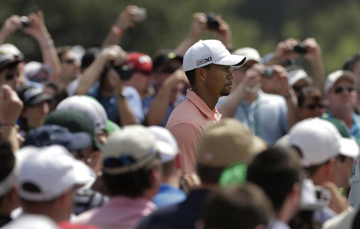 Tiger Woods waits to tee off on the first hole during a practice round for the Masters golf tournament Tuesday, April 9, 2013, in Augusta, Ga. (AP Photo/Charlie Riedel)