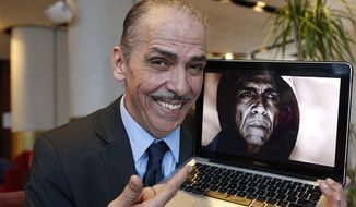 """** FILE ** Moroccan actor Mehdi Ouazanni, posing here with a frame from his role as Satan in the popular five-part mini-series """"The Bible"""" during an interview in Casablanca, Morocco, was surprised to wake up one morning and find that that some thought he looked like U.S. President Barack Obama. (AP Photo/Abdeljalil Bounhar)"""