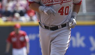 Washington Nationals' Wilson Ramos (40) rounds the bases after hitting a home run against the Cincinnati Reds in a baseball game, Saturday, April 6, 2013, in Cincinnati. (AP Photo/Al Behrman)