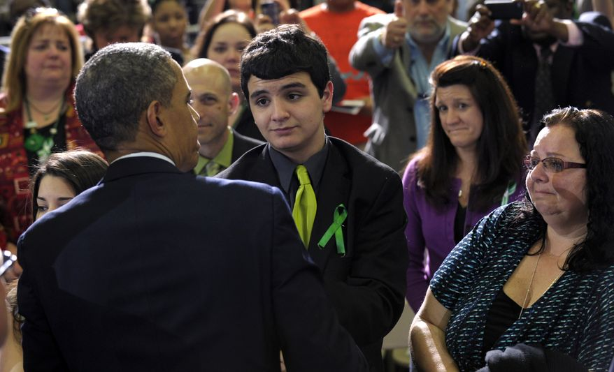 President Obama greets the family of teacher Victoria Soto, who was killed in the Newtown school shooting, including her mother, Donna Soto (right), and brother Carlos Soto (center), after his speech at the University of Hartford in Hartford, Conn., on Monday, April 8, 2013. Mr. Obama said that lawmakers have an obligation to the children killed and other victims of gun violence to act on his proposals. (AP Photo/Susan Walsh)