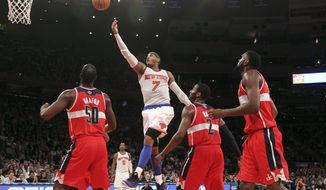 New York Knicks' Carmelo Anthony (7) goes up past Washington Wizards' Emeka Okafor (50) John Wall and Chris Singleton during the second half of n NBA basketball game, Tuesday, April 9, 2013, at Madison Square Garden in New York. The Knicks won 120-99. (AP Photo/Mary Altaffer)