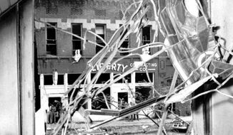 **FILE** A stained glass window in the Sixteenth Street Baptist Church is twisted and broken after a bomb blasted the building in Birmingham, Ala, in this Sept. 15, 1963 file photo. Four small black girls were killed by the blast and several were injured. (Associated Press/Birmingham News)
