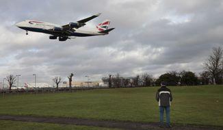 A British Airways Boeing 747 jetliner lands at London's Heathrow Airport on Monday, Jan. 10, 2011. (AP Photo/Lefteris Pitarakis)