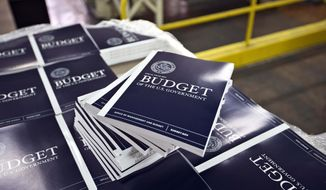 "In this April 8, 2013, photo, copies of President Barack Obama's budget plan for fiscal year 2014 are prepared for delivery at the U.S. Government Printing Office in Washington. Obama is sending Congress on Wednesday, April 10, his long-awaited budget, an effort to achieve an elusive ""grand bargain"" to tame run-away deficits that have soared above $1 trillion for each of the past four years. (AP Photo/J. Scott Applewhite)"