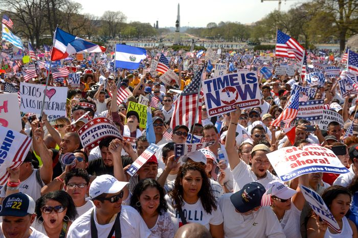 **FILE** Hundreds of people attend the National Rally for Citizenship on the west lawn of the U.S. Capitol in Washington on April 10, 2013, to call for immigration reform. (Andrew Harnik/The Washington Times)