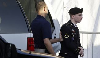 Army Pfc. Bradley Manning (right) is escorted from a security vehicle to a courthouse at Fort Meade, Md., on Wednesday, April 10, 2013, before a pretrial military hearing. Pfc. Manning, who is charged with causing hundreds of thousands of classified documents to be published on the secret-sharing website WikiLeaks, is scheduled to face a court-martial in June. (AP Photo/Patrick Semansky)