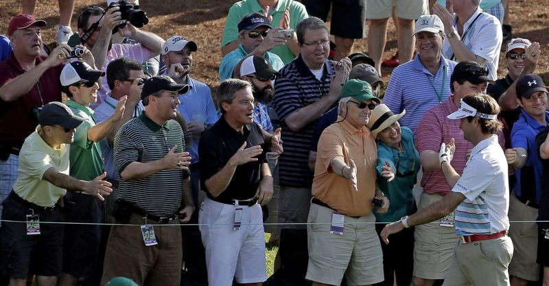Bubba Watson is congratulated by spectators after a hole-in-one on the 16th hole during a practice round for the Masters golf tournament Wednesday, April 10, 2013, in Augusta, Ga. (AP Photo/Charlie Riedel)