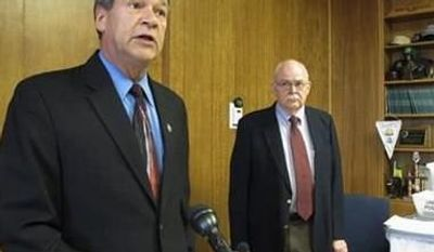 North Dakota Attorney General Wayne Stenehjem, left, speaks while North Dakota Secretary of State Al Jaeger listens at a news conference on the results of an investigation into petition fraud, Tuesday, Sept. 4, 2012 in Stenehjem's office at the Capitol in Bismarck, N.D. (Associated Press)