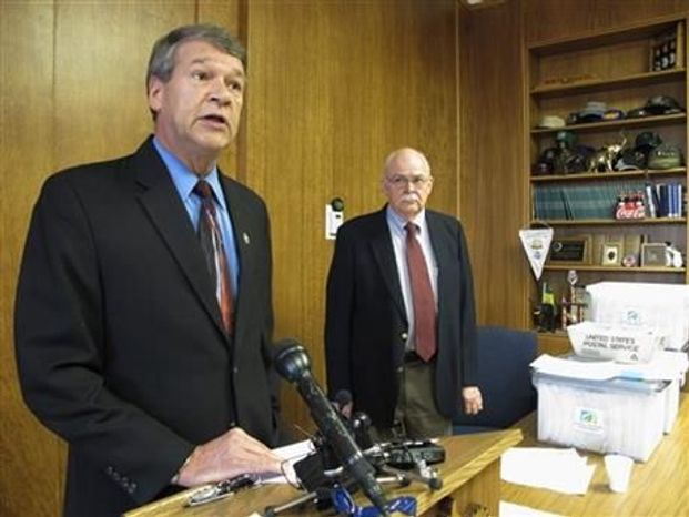 ** FILE ** North Dakota Attorney General Wayne Stenehjem, left, speaks while North Dakota Secretary of State Al Jaeger listens at a news conference on the results of an investigation into petition fraud, Tuesday, Sept. 4, 2012 in Stenehjem's office at the Capitol in Bismarck, N.D. (Associated Press)
