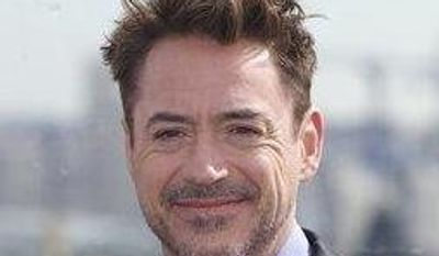Actor Robert Downey Jr poses during a photo call to promote his new movie Iron Man 3, on the roof of a hotel in Moscow, with Kremlin in the background, on Wednesday, April 10, 2013. (AP Photo/Ivan Sekretarev)