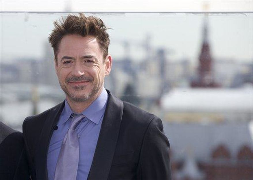 """**FILE** Actor Robert Downey Jr. poses during a photo call to promote his new movie """"Iron Man 3"""" on the roof of a hotel in Moscow, with Kremlin in the background, on April 10, 2013. (Associated Press)"""
