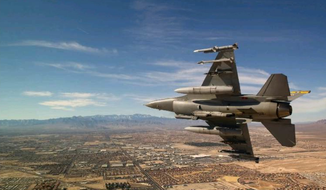 Fewer F-16s and other fighter jets are flying over Nellis Air Force Base near Las Vegas. These days, operators at the base conduct surveillance and hunt-and-kill missions in the safety of controls thousands of miles away. (United States Air Force) ** FILE **