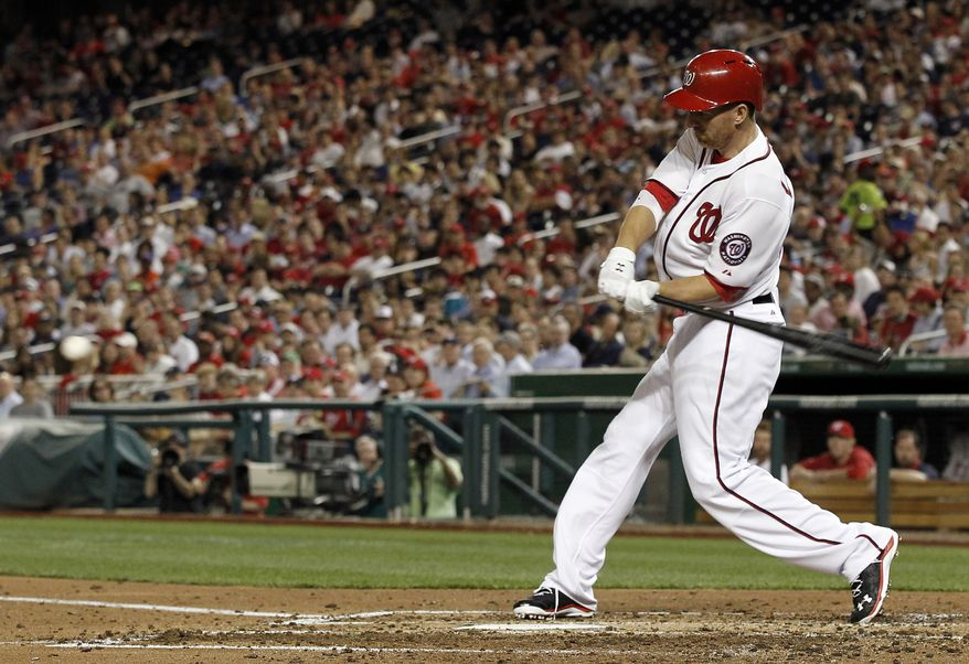 Adam LaRoche hits a two-run home run in the sixth inning Tuesday night, one of four the Washington Nationals hit in a win over the White Sox and the first of two for the first baseman in the game. (Associated Press photo)