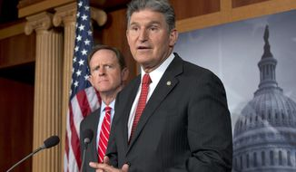 ** FILE ** Sen. Joe Manchin III (right), West Virginia Democrat, accompanied by Sen. Patrick J. Toomey, Pennsylvania Republican, announces on Wednesday, April 10, 2013, on Capitol Hill in Washington that they have reached a bipartisan deal on expanding background checks to more gun buyers. (AP Photo/J. Scott Applewhite)