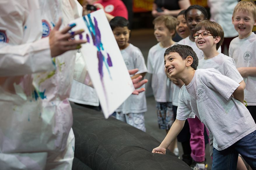 Children who are in the Young Rembrandts, a school art program, laugh with excitement as look at a painting that Kelly Anne, a 17 year old Asian elephant, painted, at George Mason University Patriot Center, in Fairfax, VA., Thursday, April 11, 2013. (Andrew S Geraci/The Washington Times)