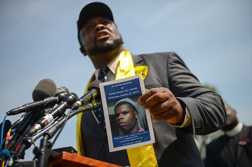 "Blackwell Memorial AME Zion Church Pastor Samuel Saylor of Hartford, Conn. speaks to members of the media about his son, Shane Isaiah ""KC"" Oliver who was shot to death in the back in 2012 as religious leaders around the country begin a 24-hour vigil on the National Mall to honor the victims of gun violence since the school shooting in Newtown, Conn., Washington, D.C., Thursday, April 11, 2013.(Andrew Harnik/The Washington Times)"