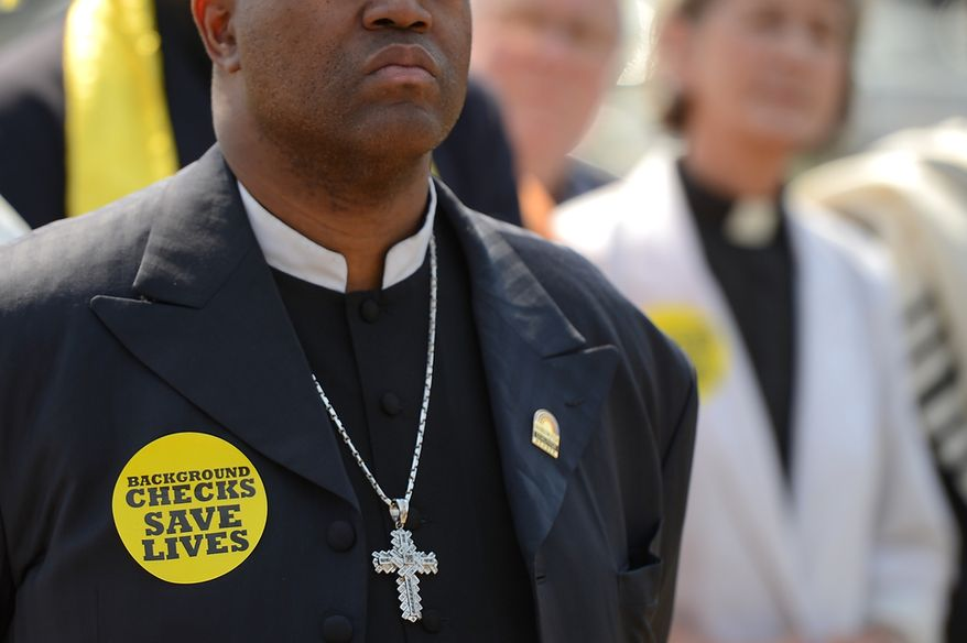 Pastor Joseph Bryant of San Francisco, Calif., stands with other religious leaders around the country for a press conference as they begin a 24-hour vigil on the National Mall to honor the victims of gun violence since the school shooting in Newtown, Conn., Washington, D.C., Thursday, April 11, 2013.(Andrew Harnik/The Washington Times)