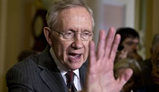 **FILE** Senate Majority Leader Harry Reid, Nevada Democrat, speaks with reporters following a Democratic strategy session at the Capitol in Washington on April 9, 2013. (Associated Press)