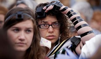 Israeli women pray at the Western Wall in Jerusalem, Thursday, April 11, 2013. Israeli police have detained five women while praying at the Western Wall in Jerusalem for performing religious rituals that ultra-Orthodox Jews say are reserved for men. (AP Photo/Michal Fattal)