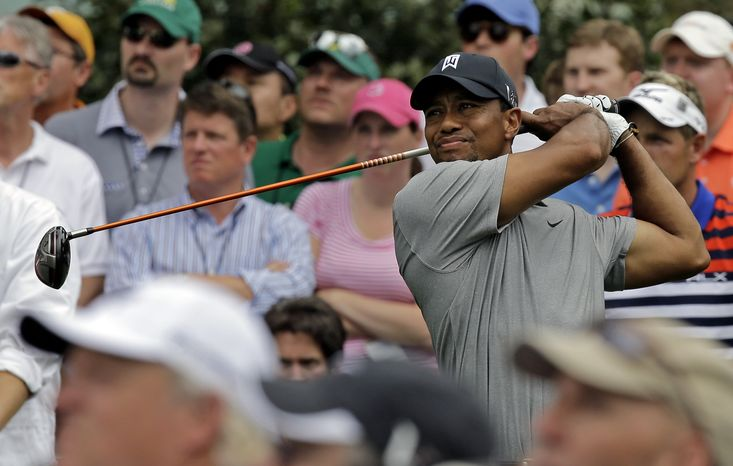 Tiger Woods tees off on the 15th hole during the first round of the Masters golf tournament Thursday, April 11, 2013, in Augusta, Ga. (AP Photo/David J. Phillip)