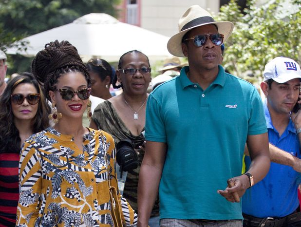 **FILE** Married musicians Beyonce (left) and Jay-Z tour Old Havana on April 4, 2013. (Associated Press)