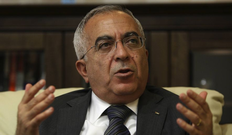 In this June 28, 2011, file photo, then-Palestinian Prime Minister Salam Fayyad speaks during an interview with The Associated Press in the West Bank city of Ramallah. (AP Photo/Majdi Mohammed, File)