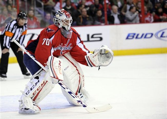 Washington Capitals goalie Braden Holtby (70) waits for the action during the first period of an NHL hockey game against the Buffalo Sabres, Sunday, March 17, 2013, in Washington. (AP Photo/Nick Wass)