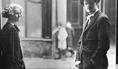 James Joyce and Sylvia Beach outside the door of Shakespeare and Company on the Rue de l'Odeon in Paris in 1920