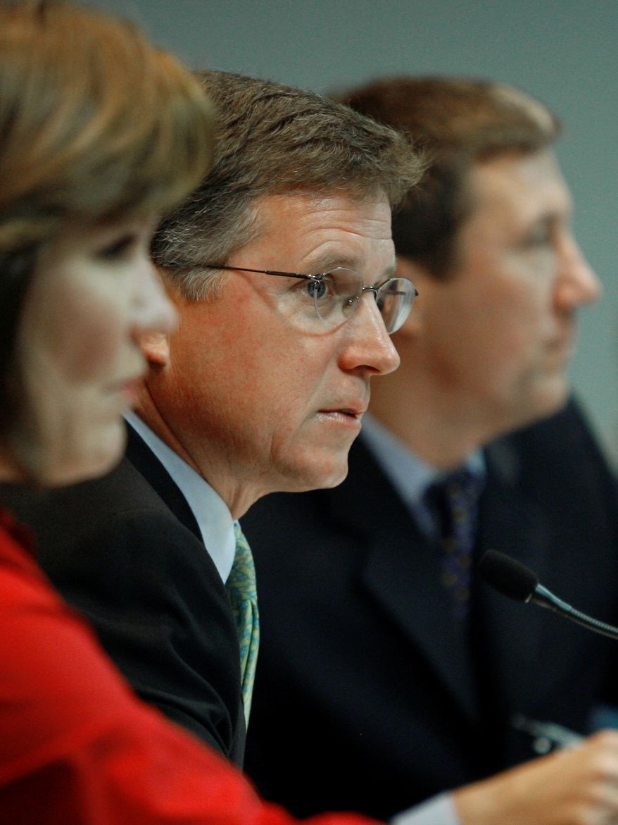 **FILE** Chairman Barry Smitherman (center) presides during a meeting of the Public Utility Commission of Texas on July 17, 2008, in Austin, Texas. (Associated Press)