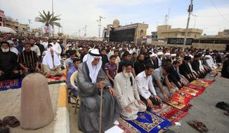 ** FILE ** Followers of radical Shiite cleric Muqtada al-Sadr attend Friday prayers in the Sadr City neighborhood in Baghdad, Iraq, Friday, March. 29, 2013. (AP Photo/Karim Kadim)