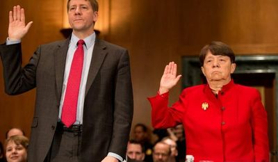 Richard Cordray and Mary Jo White are sworn in March 12, 2013, before testifying in front of the U.S. Senate Banking, Housing and Urban Affairs Committee on Capitol Hill for their confirmation hearings. Cordray and White are President Obama's picks to head the Consumer Financial Protection Bureau and the Securities and Exchange Commission, respectively. (Andrew Harnik/The Washington Times)