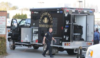**FILE** Flagstaff, Ariz., police respond April 11, 2013, to a bomb threat at the Flagstaff Post Office on Postal Boulevard. An explosive device in a package addressed to Sheriff Joe Arpaio at his downtown Phoenix office was intercepted, the Maricopa County Sheriff's Office said in a statement. (Associated Press/Arizona Daily Sun)