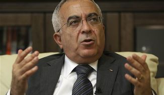 ** FILE ** Palestinian Prime Minister Salaam Fayyad speaks during an interview with The Associated Press in the West Bank city of Ramallah, June 28, 2011.