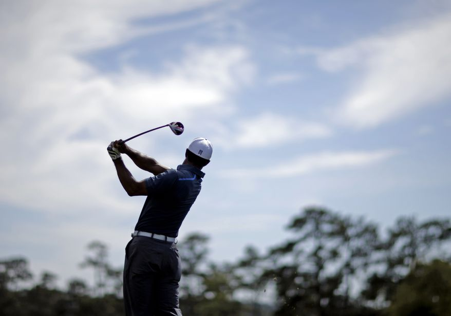 Tiger Woods tees off on the 10th hole during the third round of the Masters golf tournament Saturday, April 13, 2013, in Augusta, Ga. (AP Photo/David Goldman)