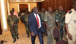 ** FILE ** Michel Djotodia (center), the rebel leader who declared himself president of Central African Republic in late March after his soldiers seized the capital, arrives for a meeting with members of the government's armed forces in Bangui, Central African Republic, on Thursday, March 28, 2013. (AP Photo)