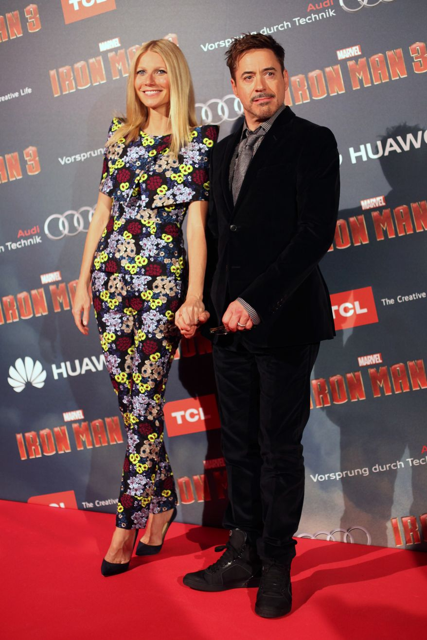 "U.S actors Robert Downey Jr. (right) and Gwyneth Paltrow pose for photographers during the ""Iron Man 3"" premiere in Paris on Sunday, April 14, 2013. (AP Photo/Thibault Camus)"