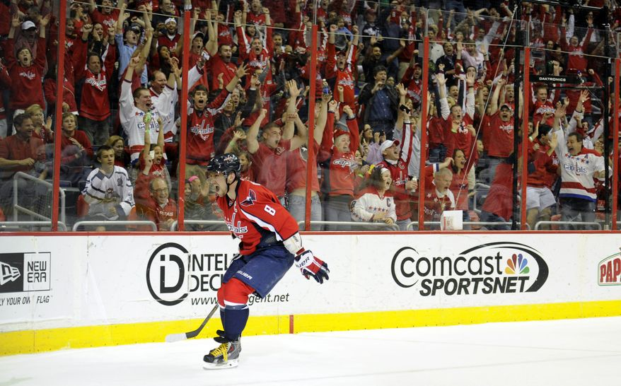 Washington Capitals left wing Alex Ovechkin (8), of Russia, celebrates his goal against the Tampa Bay Lightning during the first period of an NHL hockey game, Saturday, April 13, 2013, in Washington. (AP Photo/Nick Wass)
