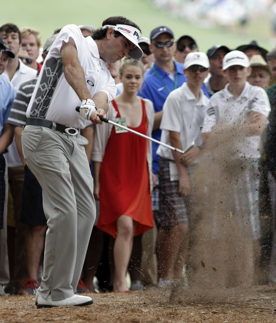 Bubba Watson hits out of the rough off the first fairway during the fourth round of the Masters golf tournament Sunday, April 14, 2013, in Augusta, Ga. (AP Photo/Darron Cummings)