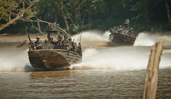 Special Warfare Combatant-craft Crewman (SWCC) move though rivers at a high rate of speed in specially designed Riverine boats outfitted with heavy weapons.  Photo: (C) 2011 Greg E. Mathieson Sr. / NSW Publications, LLC