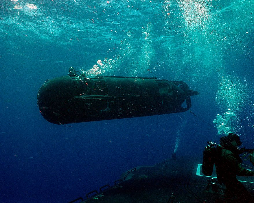 A US Navy SEAL Delivery Vehicle (SDV) moves away from a submarine onto its target as shown in the newly release coffee table top book, US Naval Special Warfare / US Navy SEALs. Photo: (C) 2011 Greg E. Mathieson Sr. / NSW Publications, LLC