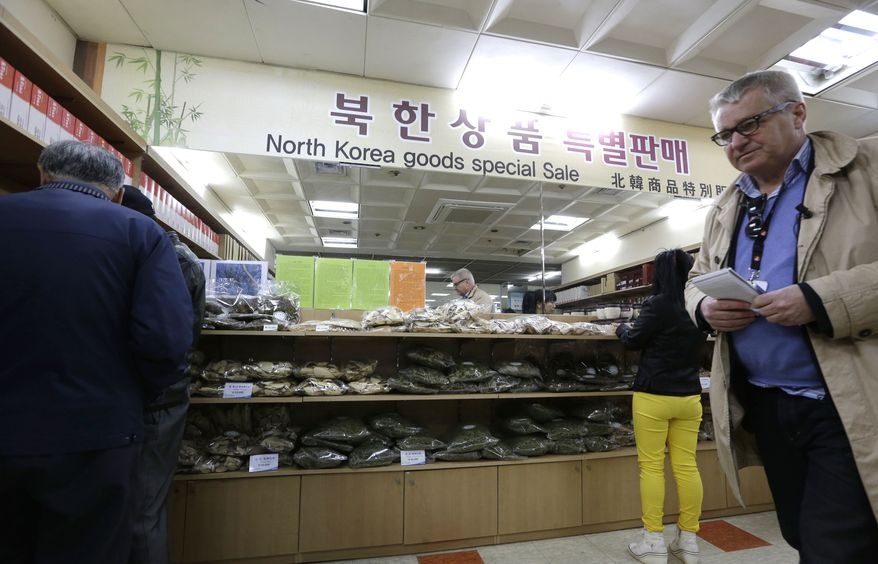 Visitors buy North Korean goods at the Imjingak Pavilion near the border village of Panmunjom, which separates the two Koreas, in Paju, north of Seoul, on Sunday, April 14, 2013. (AP Photo/Lee Jin-man)